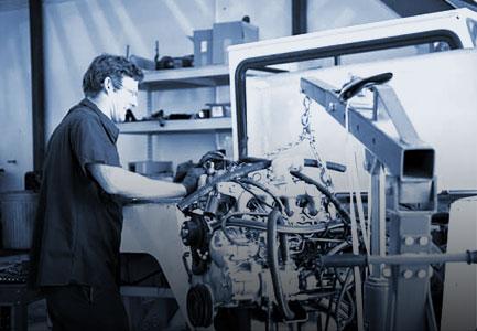 Employee repairs engine