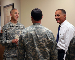 Howell talking to Military personnel.